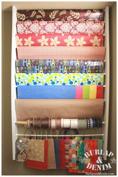 How to build a DIY wrapping paper organizer/station. This can fit in your laundry room or craft room in the space behind the door. Easy, fast, and inexpensive! ~by Burlap & Denim Part of Operation: Organization at 11 Magnolia Lane