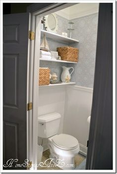 Renovate half bath with chair rail and wallpaper!