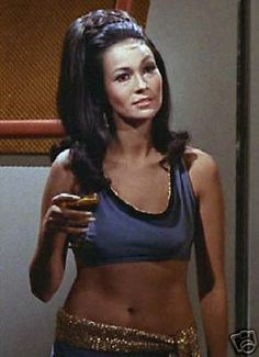Barbara Luna. Yes, I'm a dork. But she is of filipino descent and totally morena.