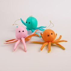 Add oceanic inspiration to your holiday tree with these handcrafted, three-dimensional sea creatures, featuring black bead eyes and brightly colored bodies with contrasting hues on their tentacles.