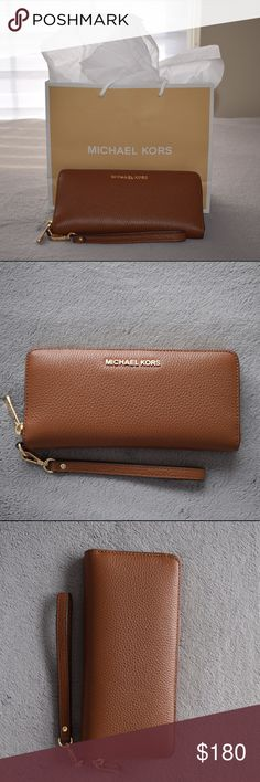 Michael Kors Wristlet This Michael Kors wristlet is brand new and never  used. There are 3dc3be0438