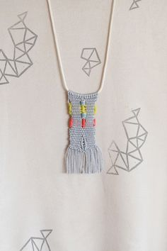 So trendy! Mini weave necklace. We'd love another one in mint, black and neon pink please