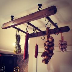 Rustic style hand made pot pan hanger for herbs, food etc - bought a ladder, adapted it and hung to the ceiling. Purchased the hooks and iron end pieces from Ebay.