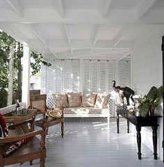 Paneled Shutters on screen porch. West Indies Screen porch paneled shutters Veranda at King's Treat, a British Colonial home for rent on Harbour Island, The Bahamas. British Colonial Decor, French Colonial, Colonial India, Home Interior, Interior Design, West Indies Style, Caribbean Homes, Estilo Tropical, Villa