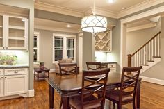 Traditional Dining Room with Pendant light, Crown molding, Hardwood floors, High ceiling, Built-in bookshelf