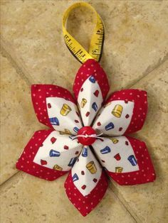 Made a few of these for my sewing buddies. Quilted Christmas Gifts, Christmas Crafts Sewing, Quilted Christmas Ornaments, Felt Christmas Decorations, Felt Ornaments, Christmas Projects, Holiday Crafts, Folded Fabric Ornaments, Beaded Ornaments