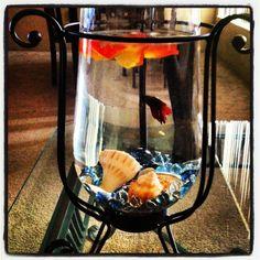 Betta fish centerpiece, but I'd put pretty rocks/plants in mine.