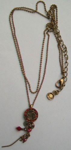 A PILGRIM Danish design pendant and double brass tone chain necklace The decorative pendant has embedded ruby glass pastes and multi-droppers Stamped Gold Necklace, Pendant Necklace, Pilgrim, Danish Design, Pendants, Brass, Stamp, Chain, Detail