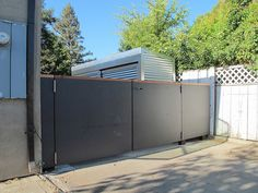 Dark Gray Fiber Cement Boards Used As Fencing Gate