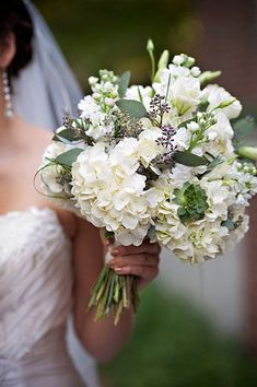 More white Bouquet, Beautiful! I like that there is a lot of mellow greens in this bouquet. Full o succulents and other non traditional stuff Hydrangea Bouquet Wedding, Bride Bouquets, Bridal Flowers, Floral Wedding, Hydrangea Boutonniere, Country Wedding Bouquets, Hydrangea Vase, Lavender Bouquet, White Hydrangeas