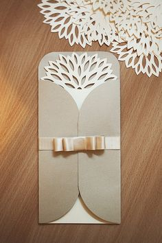 Beautiful papercutted wedding invitation    Cute - wonder if this would be an idea for on the edge dies or partial die cutting