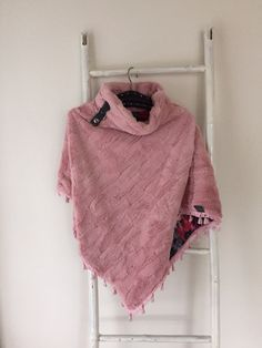 Made by Keet handmade poncho for a sweet little girl.