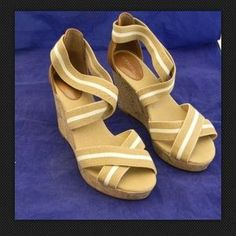 I just discovered this while shopping on Poshmark: Merona Emilia Canvas Cork Wedge Platform Sandals. Check it out! Price: $12 Size: 8
