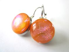 Handmade dichroic glass earrings. Tangerine with hints of pink!