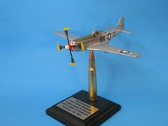 Using PropBlurs on a unique award - note the 50 cal. cartridge used as stand for the P51 Mustang aircraft model...model using PropBlur to simulate propeller in motion from PropBlur.com P51 Mustang, Model Airplanes, Aircraft, Note, Unique, Aviation, Airplanes, Airplane, Plane