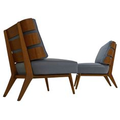 Armless lounge chairs in walnut with angled, steam-bent slat backs, designed by T.H. Robsjohn-Gibbings for Widdicomb Furniture (model #1712), produced c. 1954
