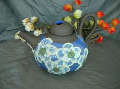 Ceramic Teapot in Sky Blue with Poppies on Black Mountain By Sally Anne Stahl at www.clayshapergallery.com