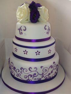 Purple wedding cake www.facebook.com/kirstiescakesuk