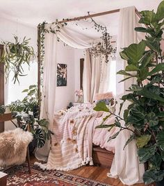Flowy curtains and some hangings from the bed lending a great bohemian feel to this house decor idea. The fascinating use of few graphic arts are also playing their part in enhancing the charm of the place. Throwing different style bedding items, and the colorful rug both are leading this boho style to the boundaries of perfection.