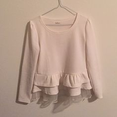 Cream top with ruffled hem Beautiful top with intricate ruffles at the hem area. Last layer is organza. Goes well with jeans or a mini skirt. Tops Tees - Long Sleeve