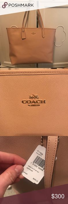 Brand New COACH Shoulder Bag NWT. Never worn. Photo shown for size reference. Flawless condition. Color is very light pink. Perfect for travel. Coach Bags Shoulder Bags