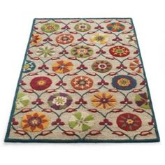 """Wellsboro Area Rug  many sizes - 2'8"""" x 8' - $200  Our vibrant and sculpted rug combines a handcarved-wool suzani design, a neutral jute ground, and a narrow indigo wool border. The combination of hand-tufted wool and looped jute creates an impressive texture.     •Richly dimensional area rug with a colorful suzani design  •Handcarved wool construction on a jute ground   •Cotton backing adds an extra layer of durability  •Extend the life of your rug with our Nonslip Rug Grip (sold…"""