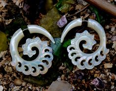 Golden honey flowing mother of pearl sea shell craved into highly detailed tribal style earrings  Natural golden lip mother of pearl is natural color