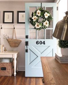 Possibly, the cutest door ever. From the lovely home of Lauren . pale french blue front door with magnolia flower wreath and board and batten foyer. Apartment Decoration, Design Apartment, Boho Home, Cool Ideas, First Home, Cozy House, Cozy Cottage, Home Decor Inspiration, My Dream Home
