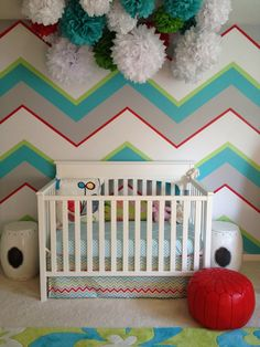 Bold colors, chevron wall, pom poms, poufs...what's not to love? Love the different thickness of the stripe