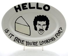 Hello Is It Brie You're Looking For?    didn't know whether to put this under humor or under kitchen gear, because I seriously want it.