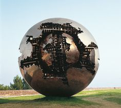 Italian sculptor Arnaldo Pomodoro is known to construct enormous spheres with layers of complexities. One of his monumental orbs stands tall as the centerpiece of the Courtyard of the Pinecone at the Vatican Museum. The structure titled Sfera con Sfera, translated as Sphere within a Sphere, is a bronze statue that appears golden as the sun shines down on it. I
