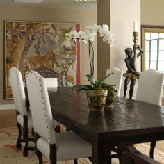 love dark stained farmhouse table with white chairs!
