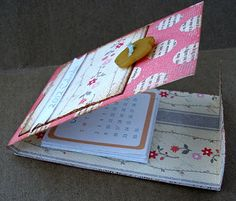Folded thick #scrapbook paper to create a desk calendar.  Tutorial to make the calendar and stand