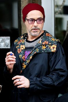Robert Downey Jr. - leaving Claridge's Hotel in London for the airport, wearing one of his trademark colorful outfits (comfy for the plane, no doubt...) - and with Sharpy in hand, ready to autograph for fans.