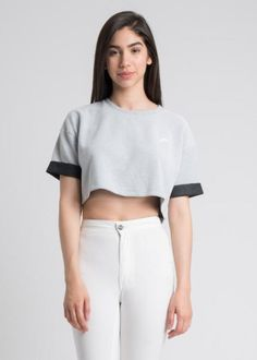 The perfect monochromawesome crop top. Two-tone long short sleeve crop top. Rock it with our Black Neoprene Pants. Fabric: 100% Polyester Bonded two-tone therma