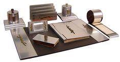 An American Art Deco aluminum with brass trim desk set by Lurelle Guild