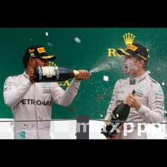 British Formula One driver Lewis Hamilton (L), of Mercedes team, and German Formula One driver Nico Rosberg (R), of Mercedes team, celebrate on the podium their respective first and second place at the Formula One Grand Prix of Brazil, at Interlagos race track in Sao Paulo, Brazil, 13 November 2016. EFE/Sebastiao Moreira (MaxPPP #photo #photos #pic #pics #picture #pictures #art #beautiful #instagood #picoftheday #photooftheday #color #exposure #composition #focus #capture #moment #sport…