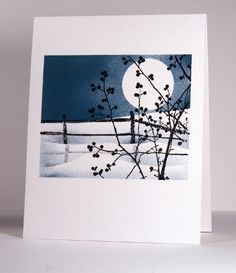 """Stunning card! The blogger said, """"In the moonscape card I punched a circle from a post it note for my moon and placed a hill mask before sponging the sky. I used two more hill masks for snow drifts and then stamped the image in black. To create the shadow I inked the fence and stamped it on a piece of clear plastic which I could then position and press onto the snow for a mirror image."""""""