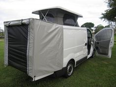 Renault Trafic camper with rear door-supported awning.