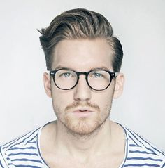 Striking. It looks almost like a passport photo. The hair, the glasses, and the apparel are variables that add so much character that this would actually make a great painting.