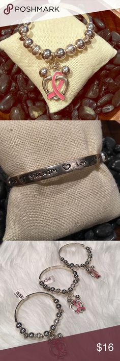 Breast cancer stretchy bangle bracelet Brand new with tags. Top of the bracelet says cure, strength, love, and hope. My husband is a two time cancer survivor. Sometimes we need to remind ourselves with little reminders! :-) Jewelry Bracelets
