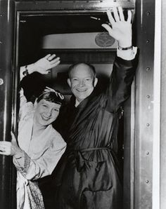 On the Campaign Trail Bathrobe-clad Ike and Mamie wave from the back platform of the campaign train. Salisbury, North Carolina. September 27, 1952.