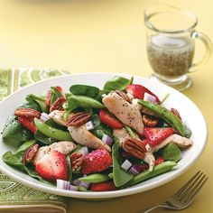 Chicken Poppy Seed Salad Recipe -Juicy berries, crisp sugar snap peas and crunchy pecans complement the lime-marinated chicken in this pretty salad. The homemade sweet-sour dressing is simply delicious. —Rebekah Radewahn, Wauwatosa, Wisconsin