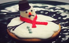 Melting snowmen cookies made by our very own Pastry Shop. Tip? Melt the marshmallow before adding the frosting!