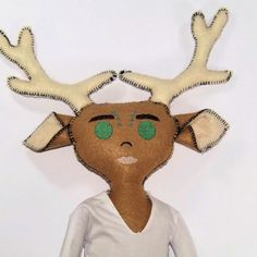This handsome deer doll can't wait for his next adventure. With his big antlers, a removable cape, white shirt, and brown pants, Gareth the cloth doll is sure to be the talk of the town! Click to see more pictures!