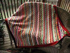 scrappy crochet. the pattern is here: http://www.freewebs.com/bethintx/scrappystepsafghan.htm