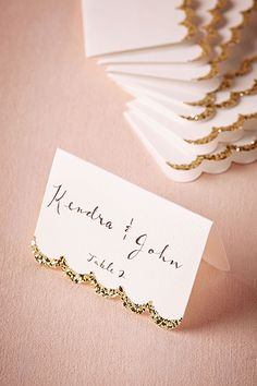 Simple glitter-dipped cardstock gives escort cards a special look.