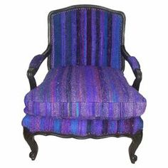 "Wrapped in silk sari upholstery, this artfully handcrafted arm chair features regal purple striping and a wood frame.  Product: ChairConstruction Material: Silk sari and woodColor: PurpleFeatures: HandmadeDimensions: 34.65"" H x 23.63"" W x 27.56"" D"