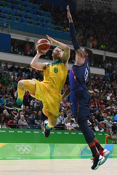 #TOPSHOT Australia's guard Matthew Dellavedova tries to score past USA's guard Paul George during a Men's round Group A basketball match between...