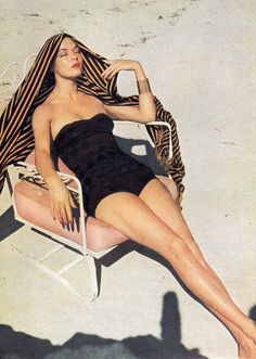 Jean Patchett, 1951, black swimsuit, lipstick, sand, chair